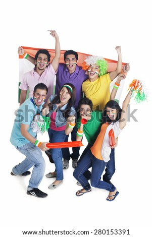Portrait of excited young friends cheering with Indian flag over white background - stock photo