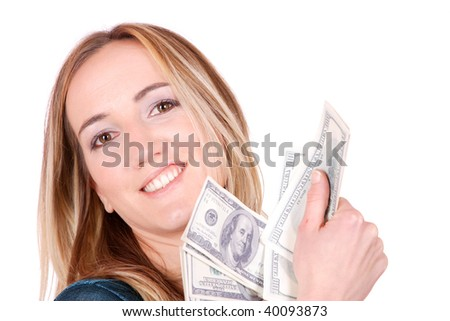 Portrait of excited young woman holding money in the hand on white background