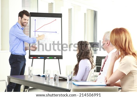 Portrait of executive businessman presenting his idea to his colleagues at meeting. Teamwork. - stock photo