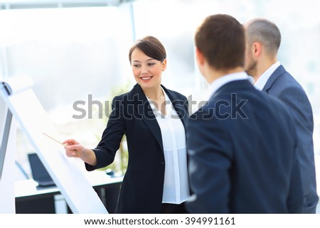 Portrait of executive businesswoman presenting his idea to his colleagues at meeting. Teamwork. - stock photo
