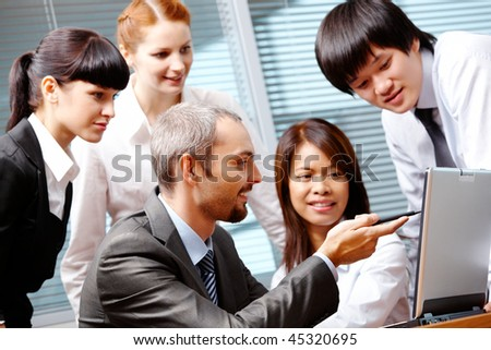 Portrait of executive employees interacting in office - stock photo