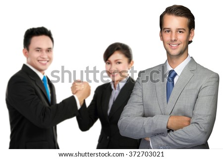portrait of executive man with team at the background. ready to success - stock photo