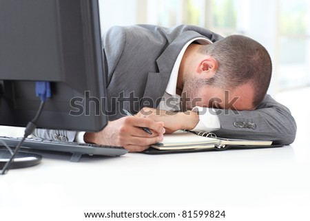 Portrait of exhausted businessman in office - stock photo