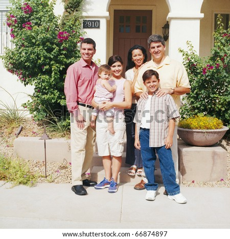 Portrait of extended family outdoors - stock photo