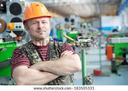Portrait of Factory Repair Man Worker on Workshop background - stock photo