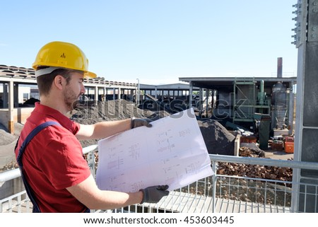 Portrait of factory worker on building site background - stock photo