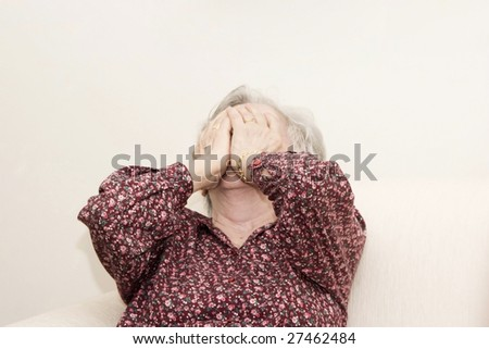 Portrait of family, crying old woman sitting - stock photo
