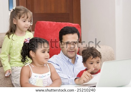 Portrait of family, dad and their children enjoying indoor with a laptop