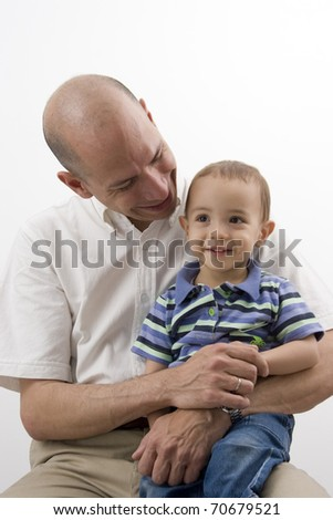 Portrait of family, dad playing with his children at home - stock photo