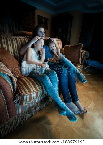 Portrait of family fell asleep on sofa while watching TV at night - stock photo