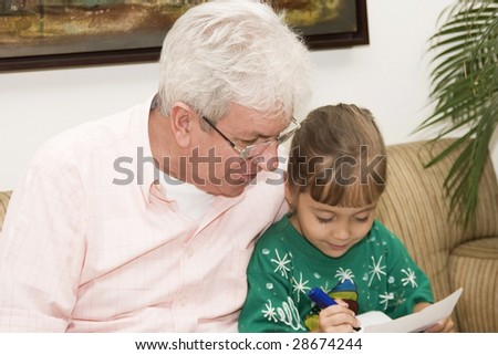 Portrait of family, grandfather enjoying with his granddaughter indoor