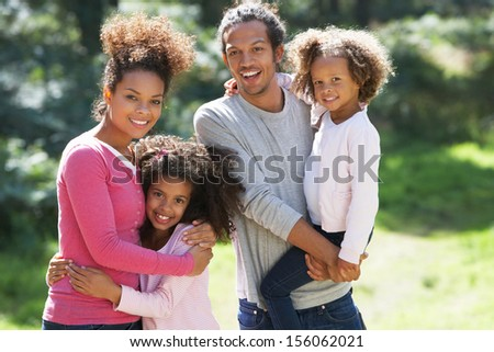 Portrait Of Family Group In Countryside Together
