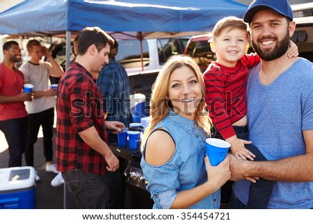 Portrait Of Family Group Tailgating In Stadium Car Park - stock photo