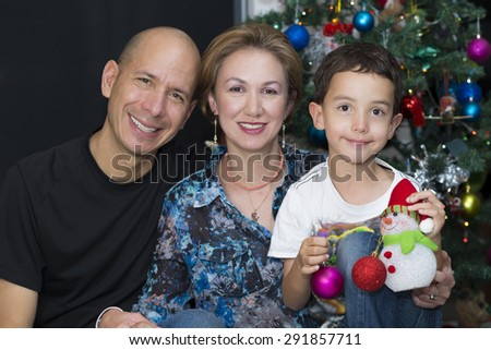 Portrait of family, Happy Family enjoying at home at Christmas - stock photo