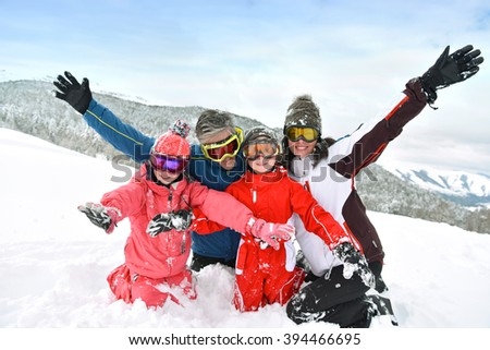 Portrait of family having fun in the snow