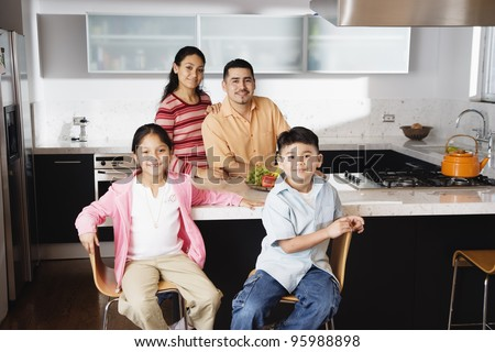 Portrait of family in domestic kitchen