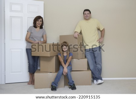 Portrait of family in new house - stock photo