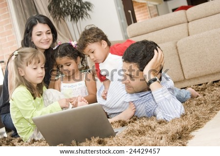 Portrait of Family, mom and dad playing with their children