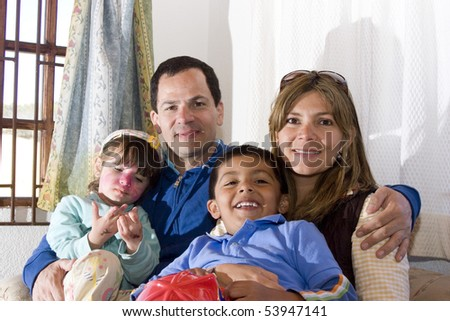 Portrait of family, mom and dad playing with their children - stock photo