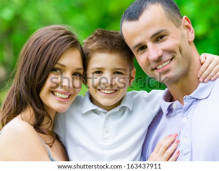 Portrait of family of three. Concept of happy family relations and carefree leisure time - stock photo