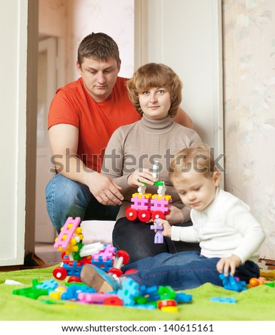 Portrait of family of three in home - stock photo