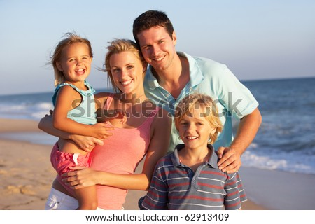 Portrait Of Family On Beach Holiday - stock photo