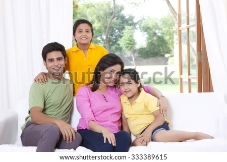 Portrait of family on sofa - stock photo