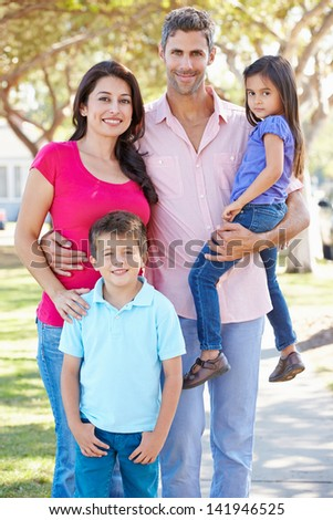 Portrait Of Family On Suburban Street