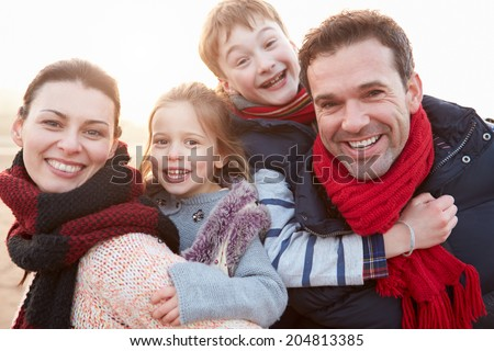 Portrait Of Family On Winter Beach - stock photo