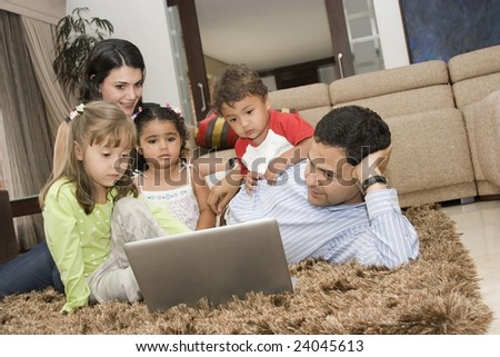 Portrait of Family, parents playing with daughter and son - stock photo