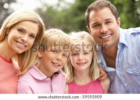 Portrait Of Family Relaxing In Countryside