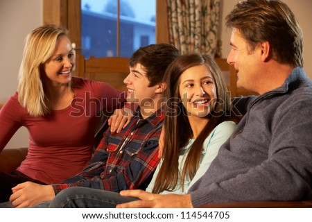 Portrait Of Family Relaxing On Sofa Together - stock photo
