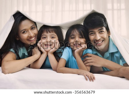 Portrait of family smiling - stock photo