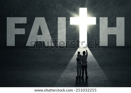 Portrait of family standing in front of faith door with cross symbol - stock photo