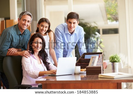Portrait Of Family Using Laptop Together - stock photo