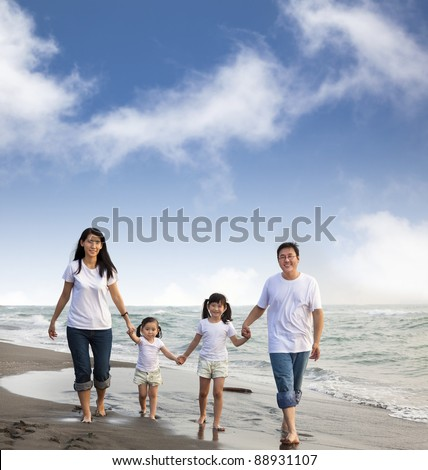 Portrait Of Family walking On the  Beach - stock photo