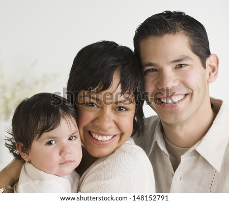 Portrait of family with baby - stock photo
