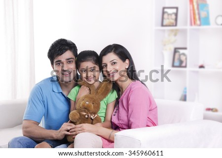 Portrait of family with stuffed toy - stock photo