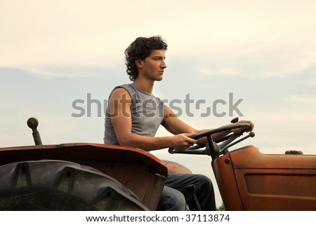 portrait of farmer driving tractor