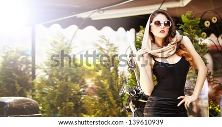 Portrait of fashion attractive  girl with headscarf and sunglasses - Outdoor on street .Retro shot. Fashion art photo of sensual lady - stock photo