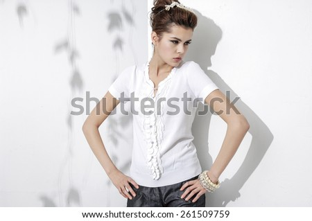 portrait of fashion girl posing in light background - stock photo