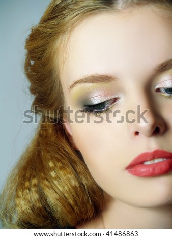 Portrait of fashion girl with brightly make up