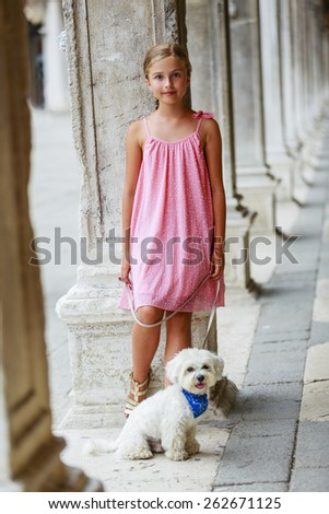 Portrait of fashion girl with maltese dog in Venice, Italy - stock photo