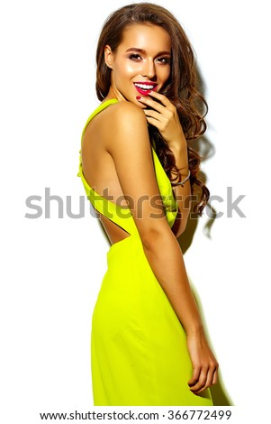 portrait of fashion glamor stylish beautiful young woman model with red lips in summer bright colorful yellow dress isolated on white