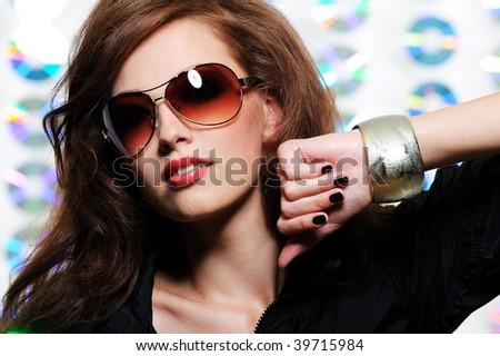 Portrait of fashion glamour beautiful brunette girl in the modern sunglasses - stock photo