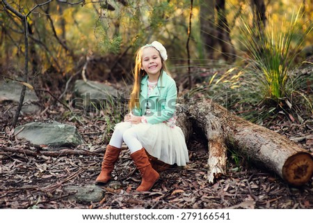 portrait of fashion little girl at autumn background - stock photo