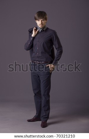 portrait of fashion man holding his jacket - stock photo