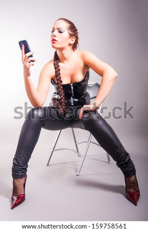 portrait of fashion model holding a cell phone - stock photo