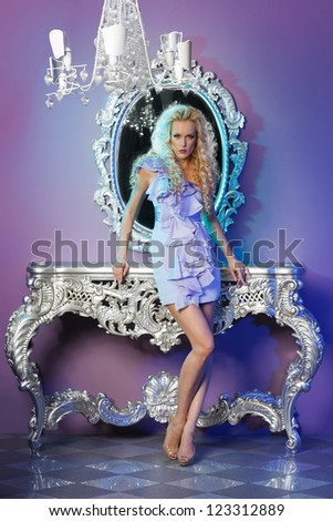Portrait of fashion model posing in glamorous interior - stock photo