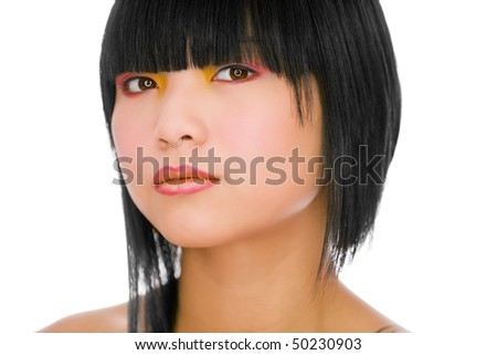 Portrait of fashion model with funky hair style on white background
